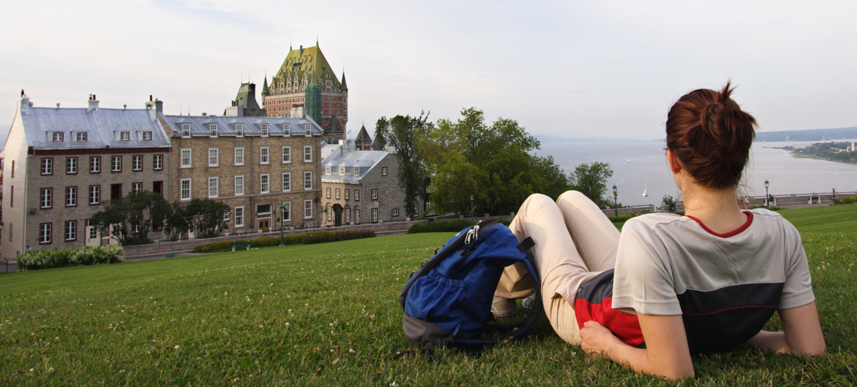 Student lying on the grass near the Chateau Frontenac